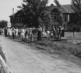 Spectators at May Day 1960 parade in front of Mashiter School