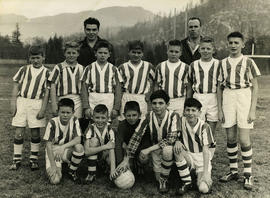 Boys' sports team photo with coaches
