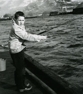 Boy fishing, cold winds