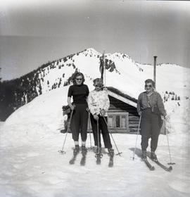Skiers outside chalet