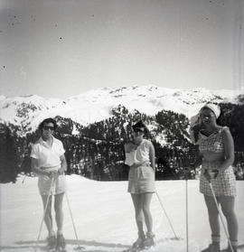 Three girls skiing