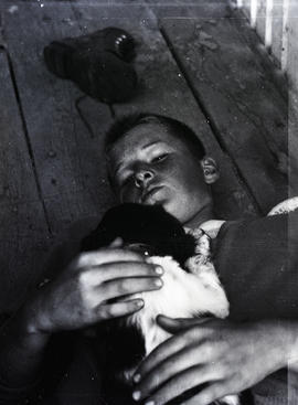 Boy and dog at Scout camp