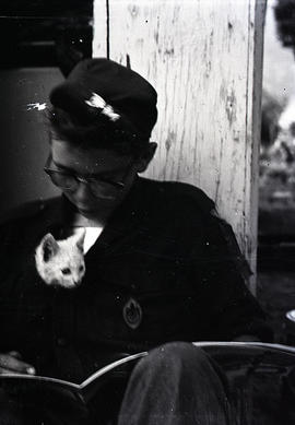 Boy and cat at Scout camp