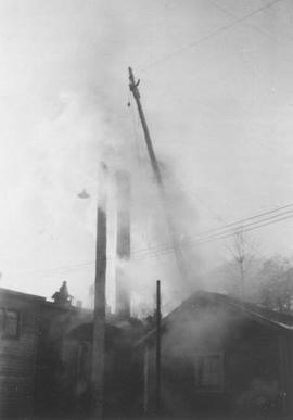 Pat Brennan placing extension on boiler smoke stack