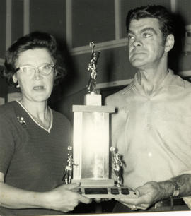 Woman and man with trophy