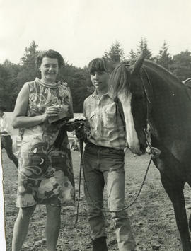 Woman, girl and horse