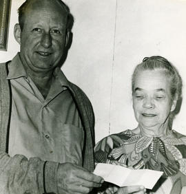 Man and woman with cheque [?]