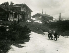 Children in front of cabin