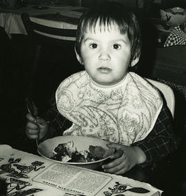 Child eating with Chieftain Hotel menu