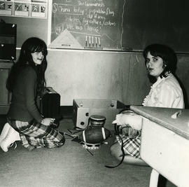 Girls with instruments in classroom