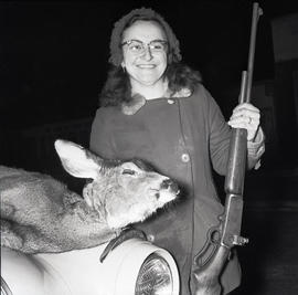Woman with dead deer