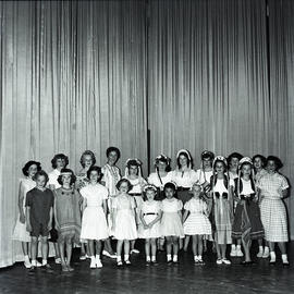Performers in front of curtain