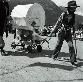 Boy pulling child in wagon