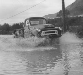 Squamish Mills truck riding over flooded road