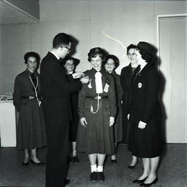 Woman receiving honour
