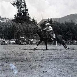 People riding horses at event