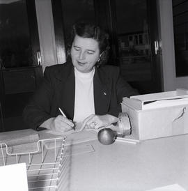 Woman writing with tickets