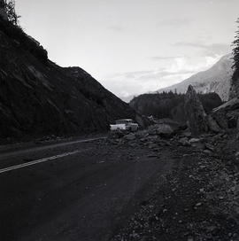 Car on road [after avalanche?]