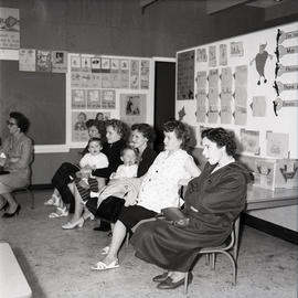 Women and young children as audience [?] in classroom