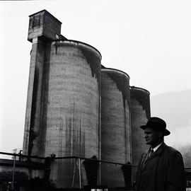Man and industrial buildings