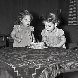 Little girls with cake
