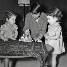 Woman and girls with cake