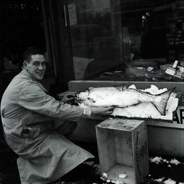 Man with dead fish