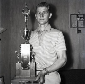 Man with Loggers Sports trophy