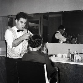 Barber cutting woman's hair