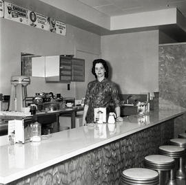 Woman behind counter in diner