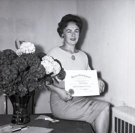 Woman with flower arranging certificate