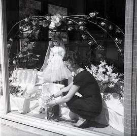 Woman in store window