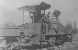 Fred Downer with Howe Sound & Northern Railway's first locomotive