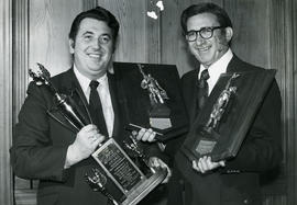 Hon. E. Hall (left) and N. Keziere with awards