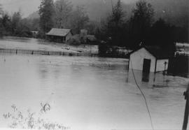 Bert & Jessie Rae's house in foreground during flood