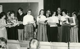 Members of senior choir singing at concert in churches