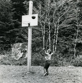 Child shooting baskets