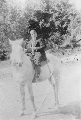 Minnie Rae on horseback