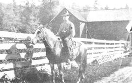 Wilfred Rae behind Huey Mills home or hop farm