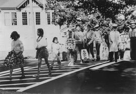 Children crossing outside Mashiter School