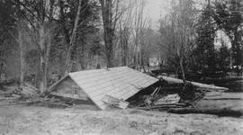 House damaged by flood washout, 1940