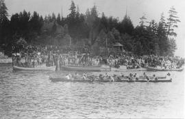Squamish Nation paddlers in Nahanee dugout canoes in North Vancouver