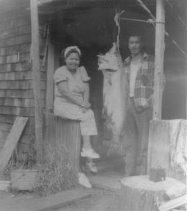 Molly Harry and Johnny Baker with a big fish