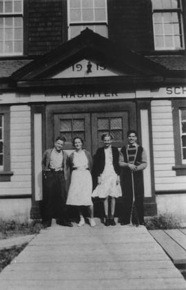 Group standing in front of Mashiter School