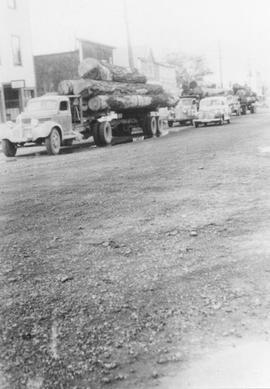 Logging trucks returning down Cleveland Avenue ~1942