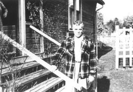 Sid Bishop in front of his house