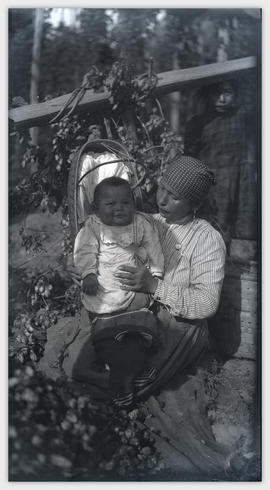 Woman hop picker with baby