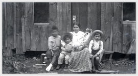 Woman with baby and three children